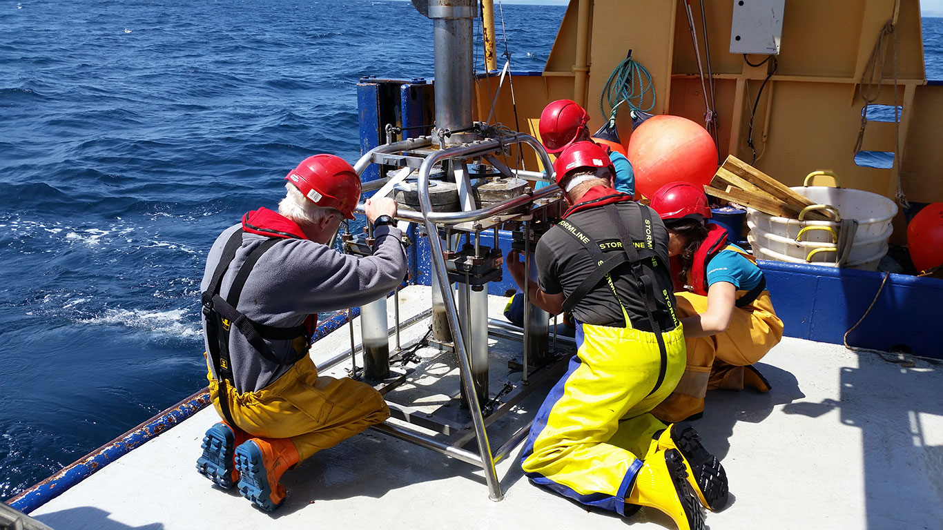 Members of research cruise working on boat